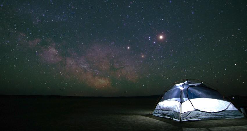 tent under starry sky at Alvord Desert